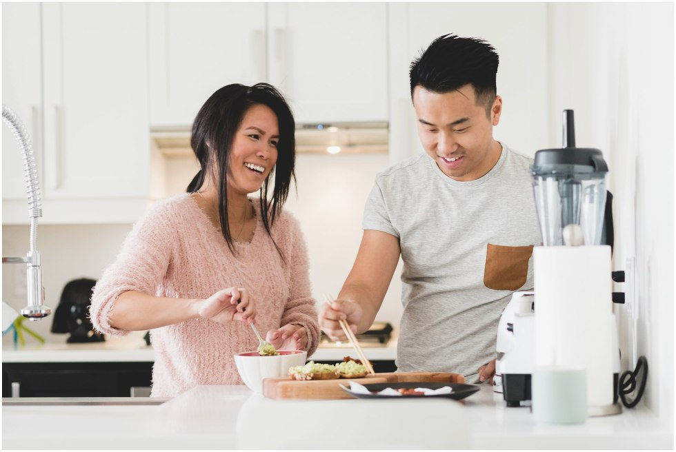 Couple making lunch during their Toronto lifestyle maternity photos.