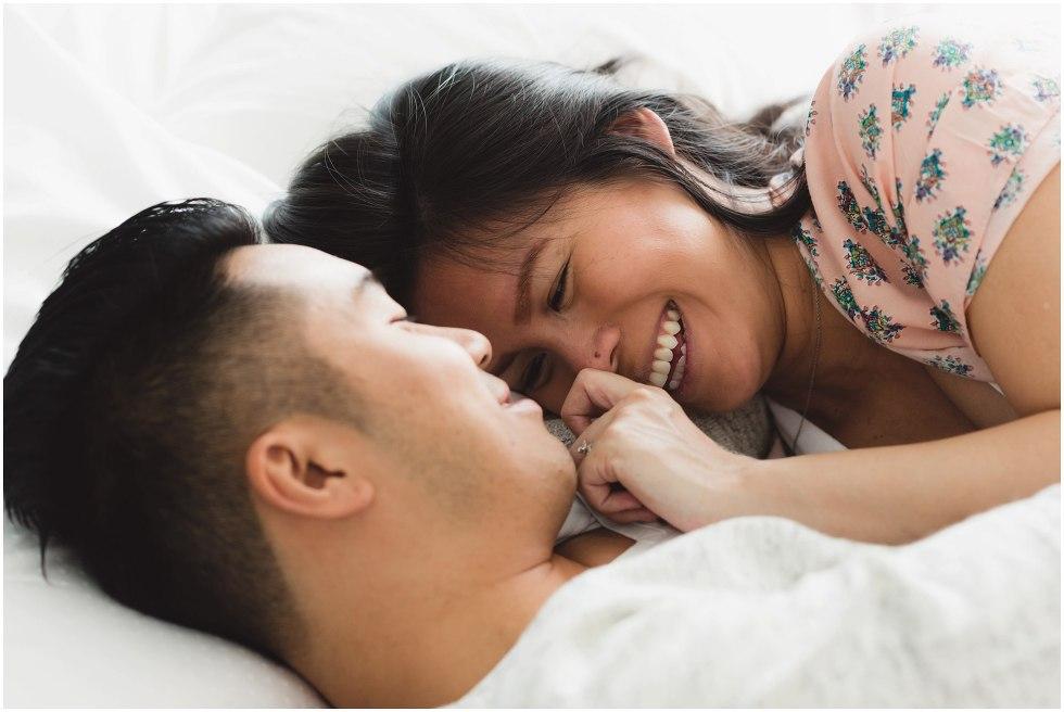 Husband and wife snuggle lovingly.
