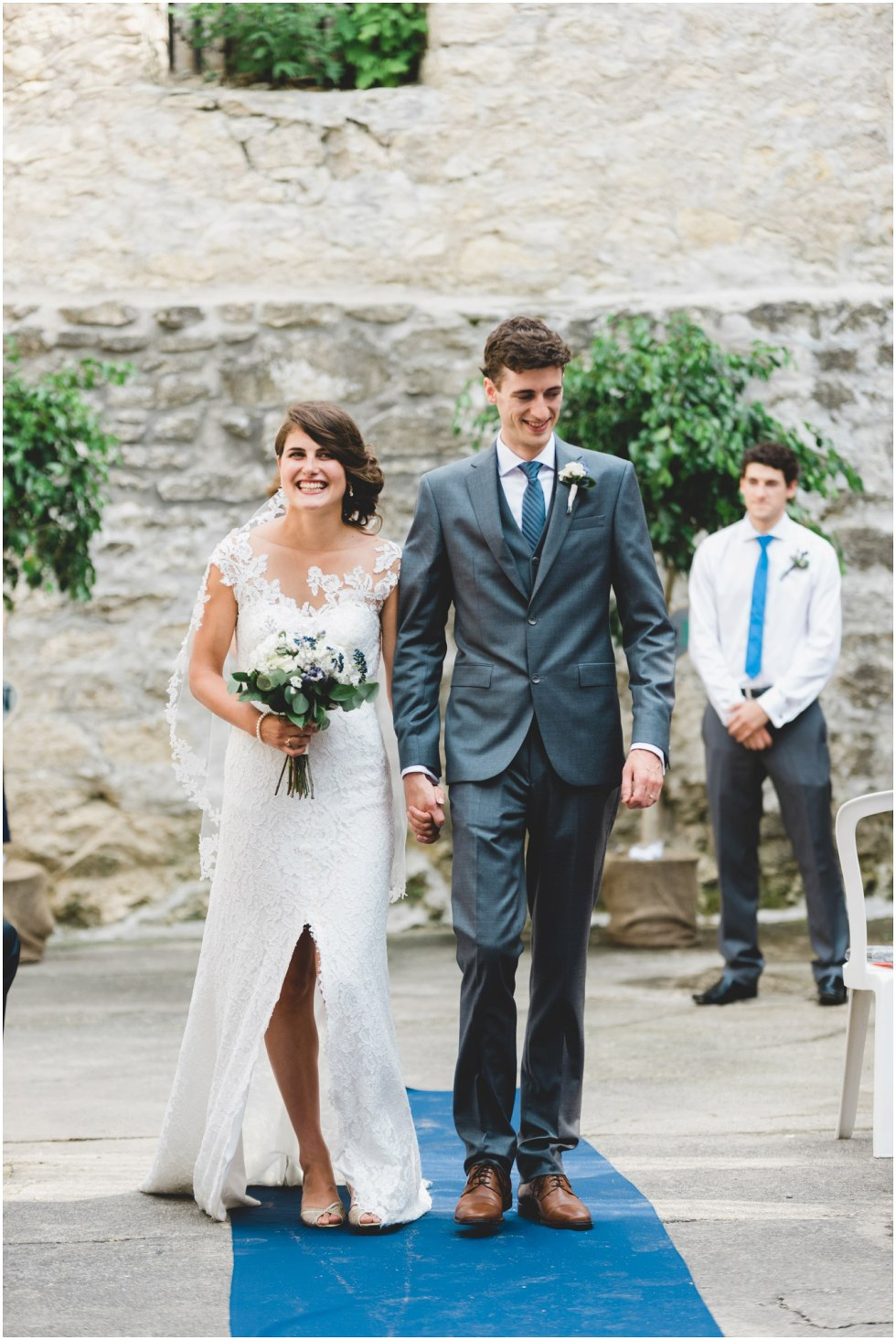 Bride and groom exiting their Goldie Mill Ruins wedding ceremony