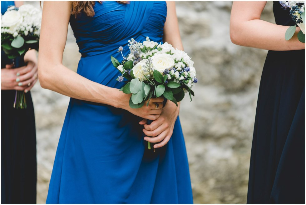 Bridesmaid holding their bouquet during the Goldie Mill Ruins wedding ceremony