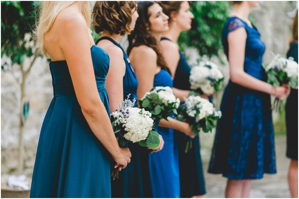 Bridesmaid holding their bouquets during the Goldie Mill Ruins wedding ceremony