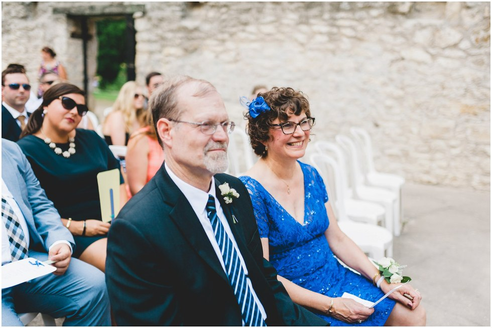 Brides parents smiling during the Goldie Mill Ruins wedding ceremony