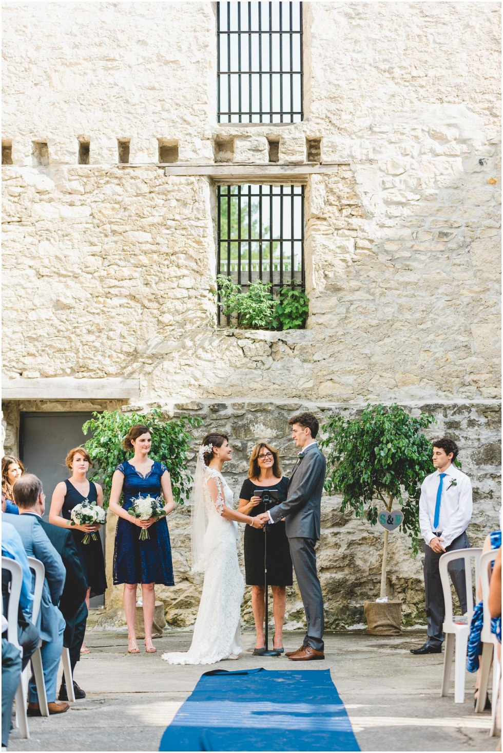 Bride and Groom saying vows during their Goldie Mill Ruins wedding ceremony