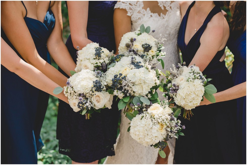 White and navy bridal bouquets all together