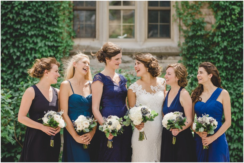 Bride and her bridesmaids smiling and laughing at the University of Guelph