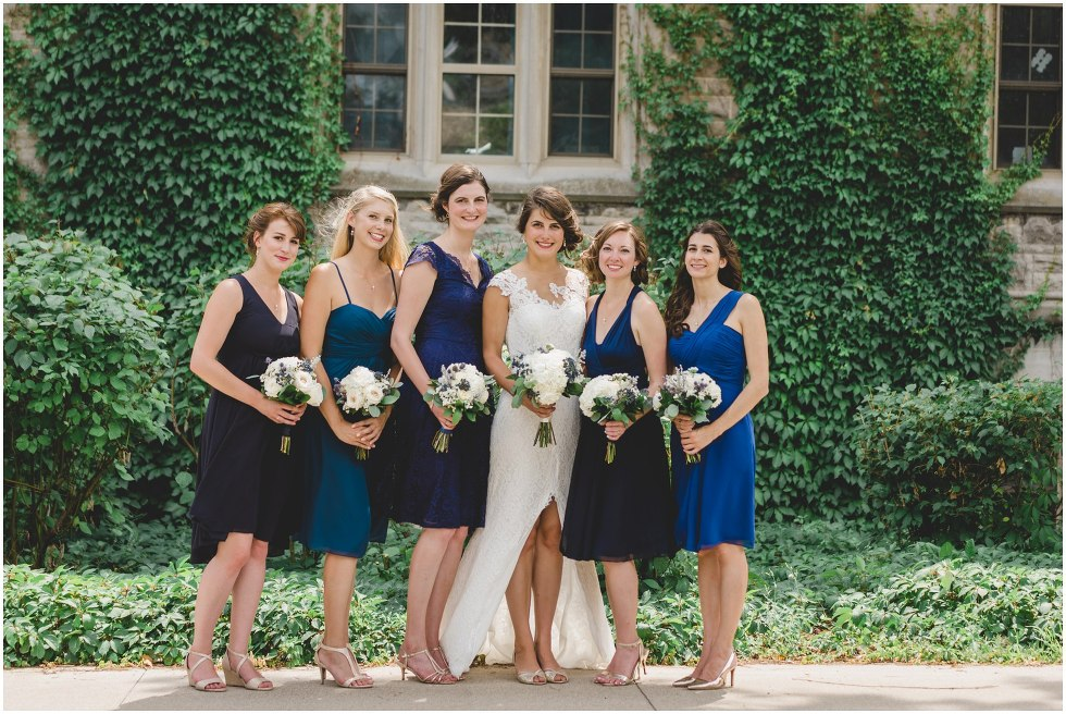 Bride and her bridesmaids in blue dresses at the University of Guelph