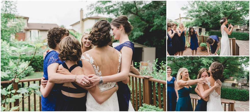 The bridal party hugging after seeing the bride