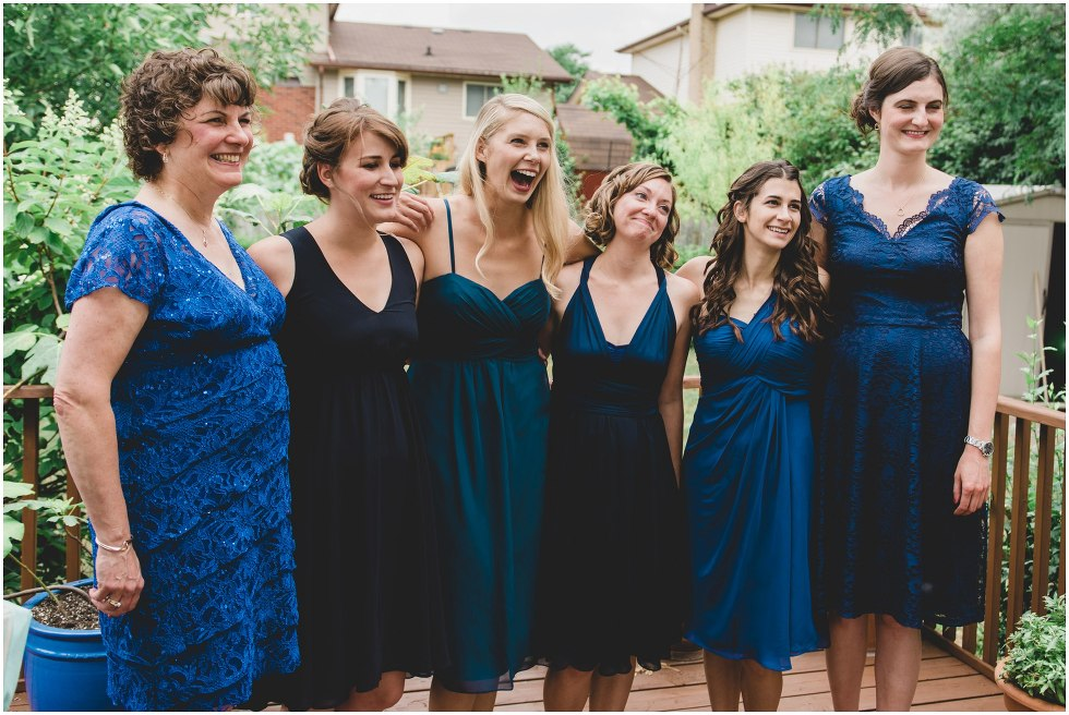 The bridal party smiling at the bride as they see her for the first time