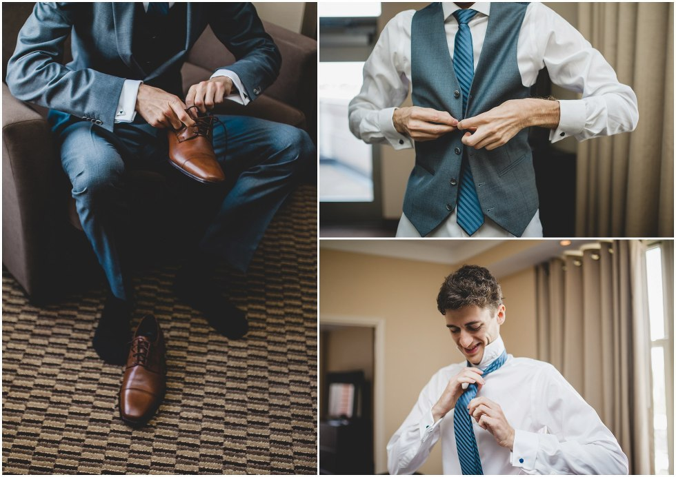 Groom getting ready by tying his tie and shoes
