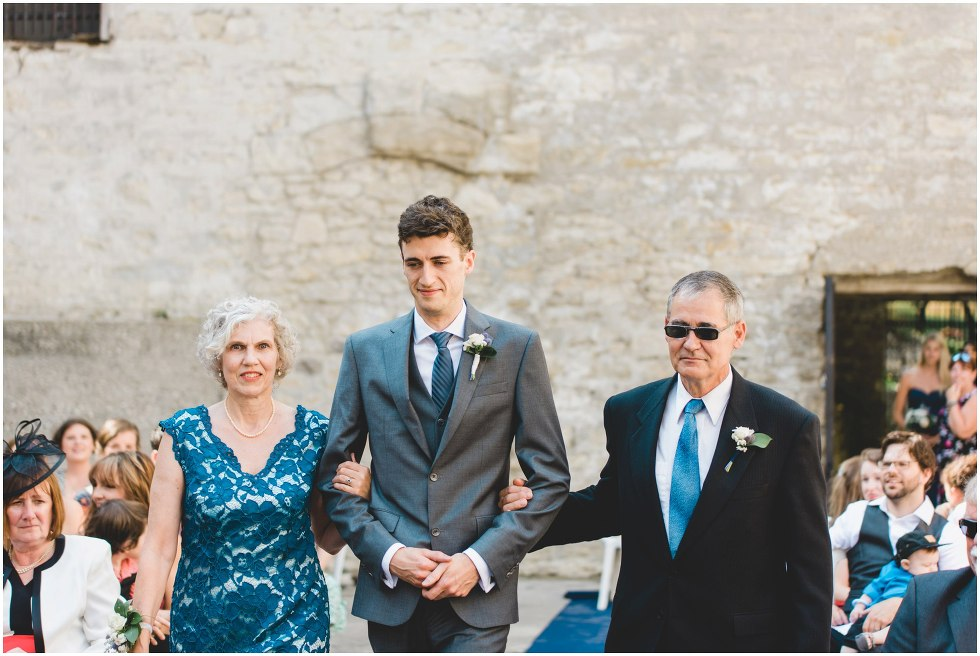Grooms parents walking him down the isle during their Goldie Mill Ruins ceremony