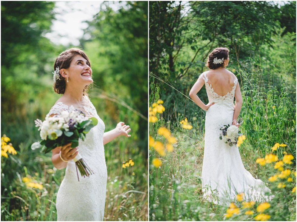 Bride smiling in a field with tall grass and yellow flowers