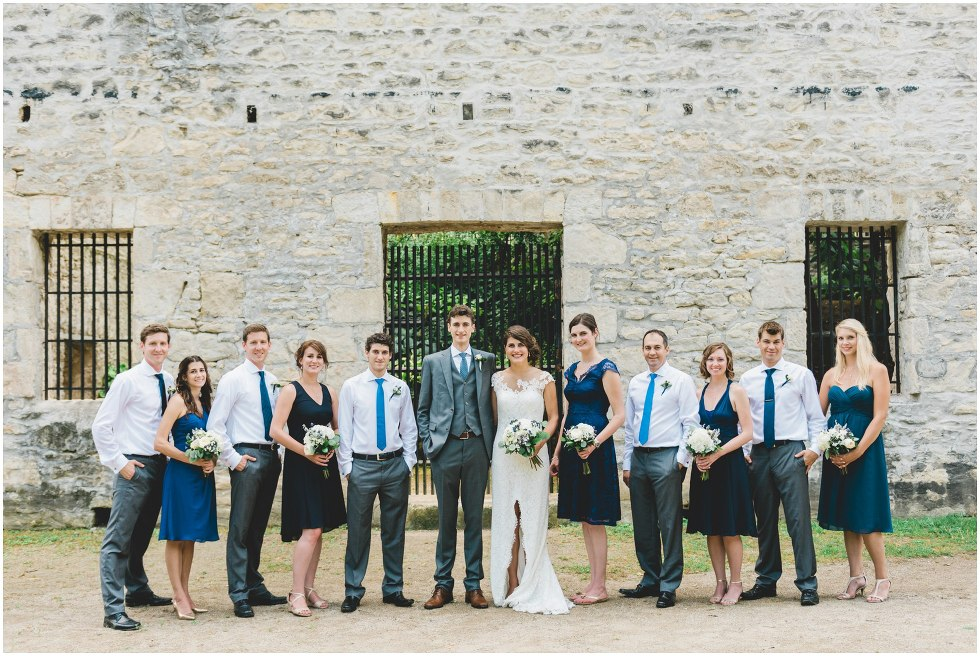Wedding party standing together in front of Goldie Mill Ruins