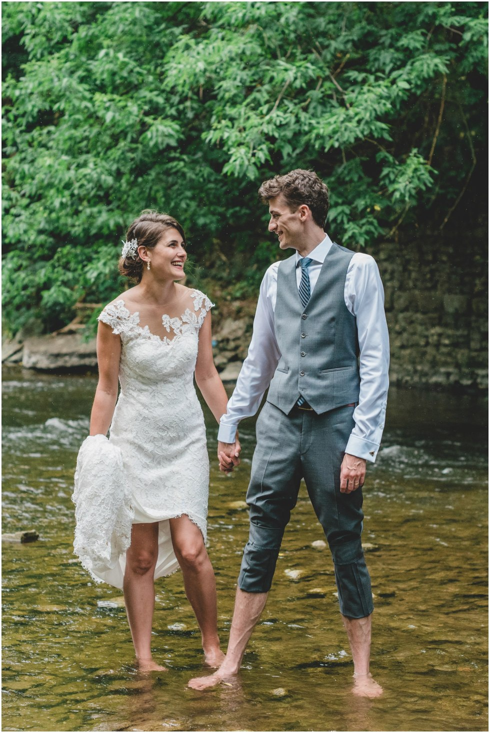 Bride and Groom laughing and smiling in the rain during their Goldie Mills Ruins wedding