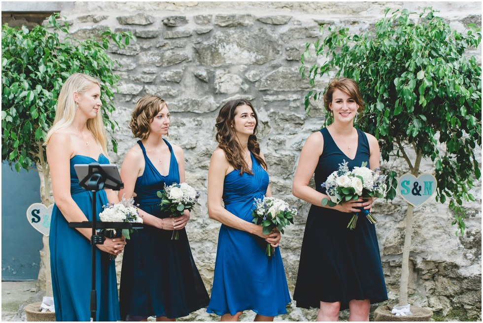 Bridesmaids smiling during the Goldie Mill Ruins wedding ceremony