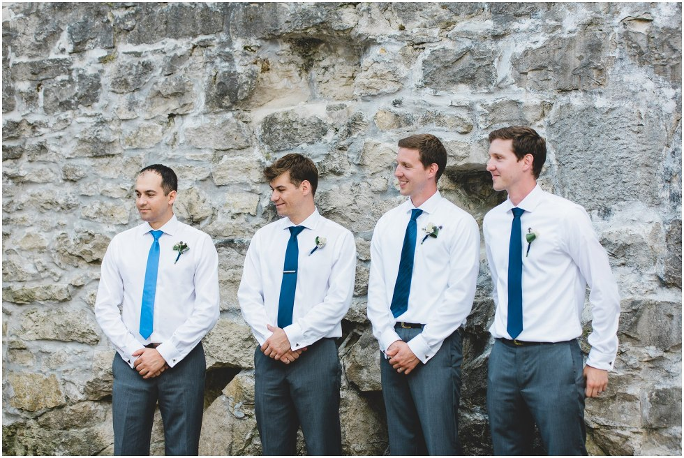 Groomsmen smiling during the Goldie Mill Ruins wedding ceremony