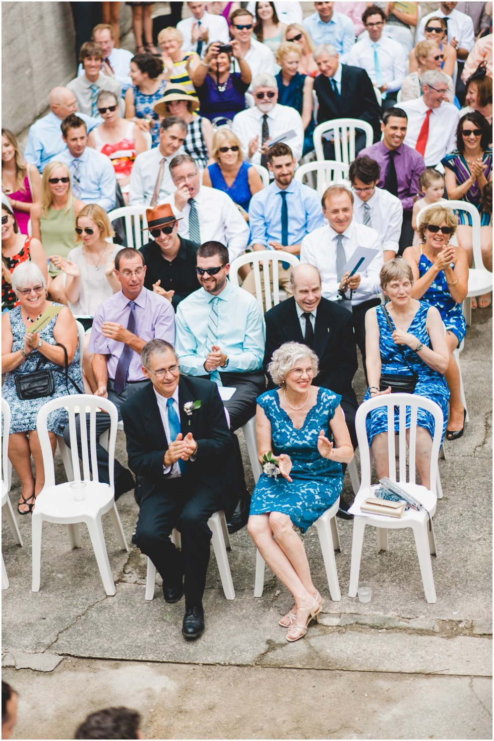 Guests smiling and clapping during the Goldie Mill Ruins wedding ceremony