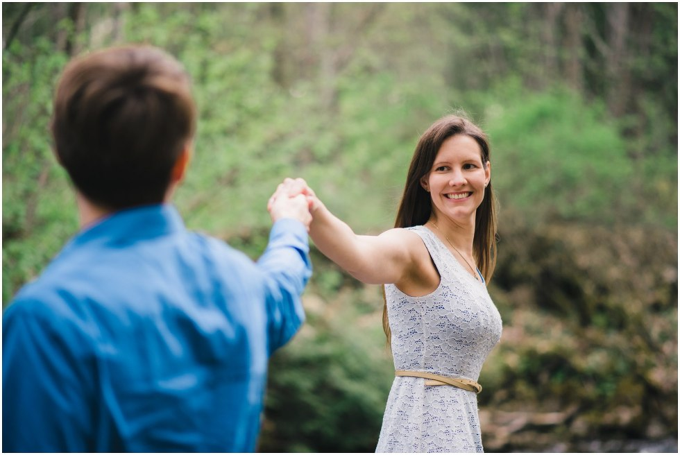 Bride to be smiling at her fiance during their Hilton Falls engagement photos