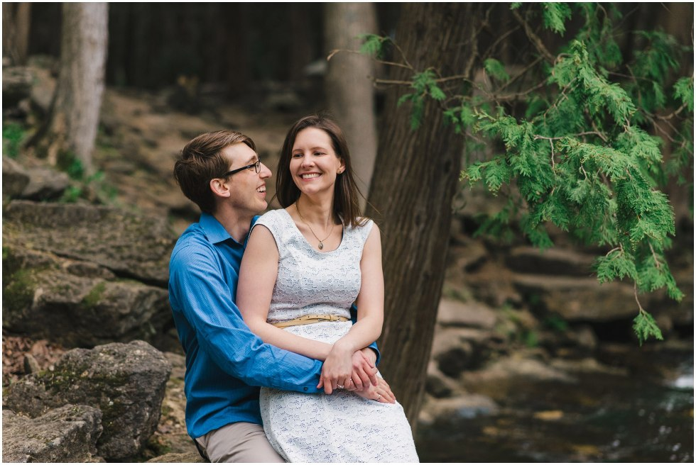 Man and woman laughing and hugging at Hilton Falls conservation area