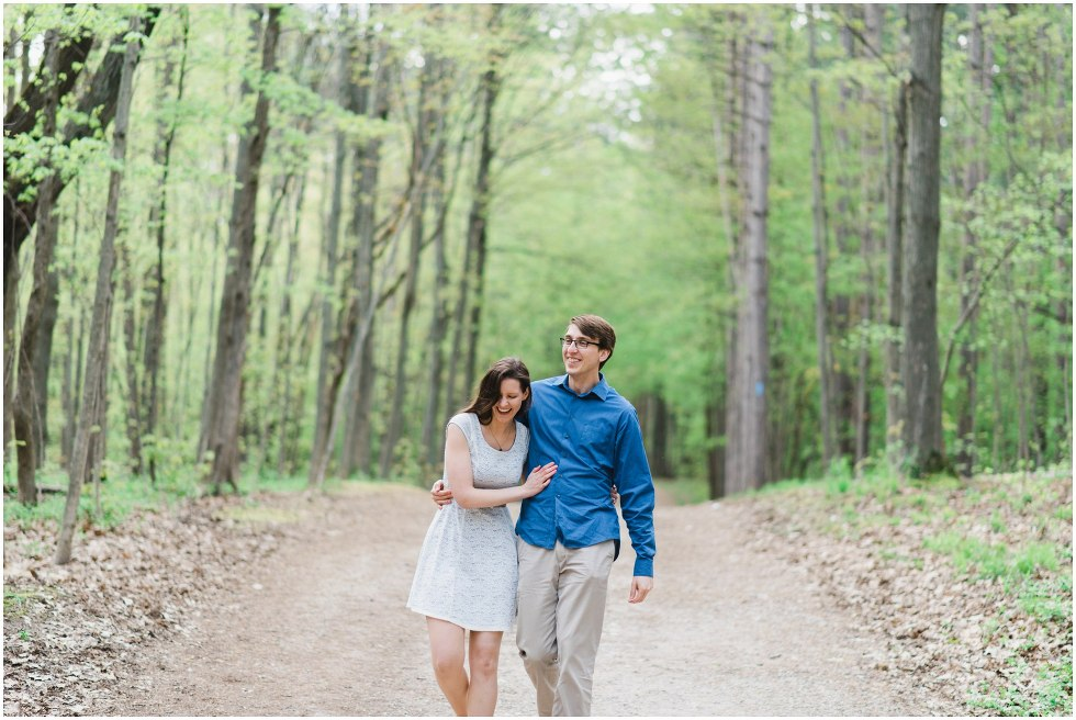 Couple smiling and walking through the Hilton Falls conservation area