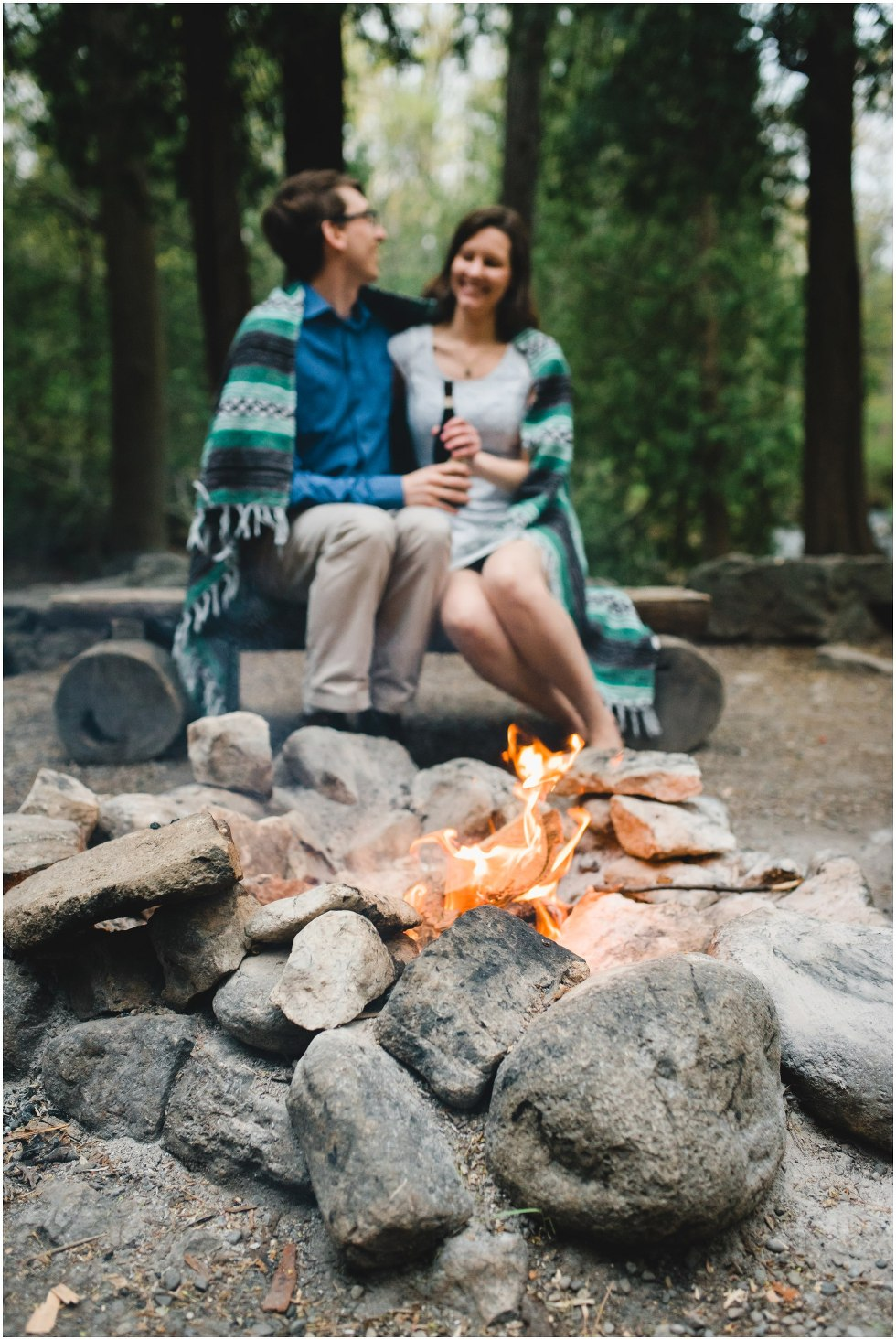 Couple sitting by the fire for their Hilton Falls engagement photos