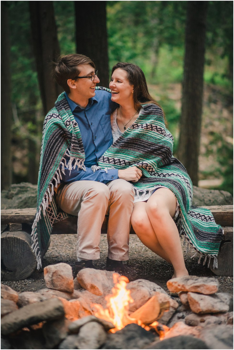 Couple smiling and laughing by the first for their Hilton Falls engagement photos