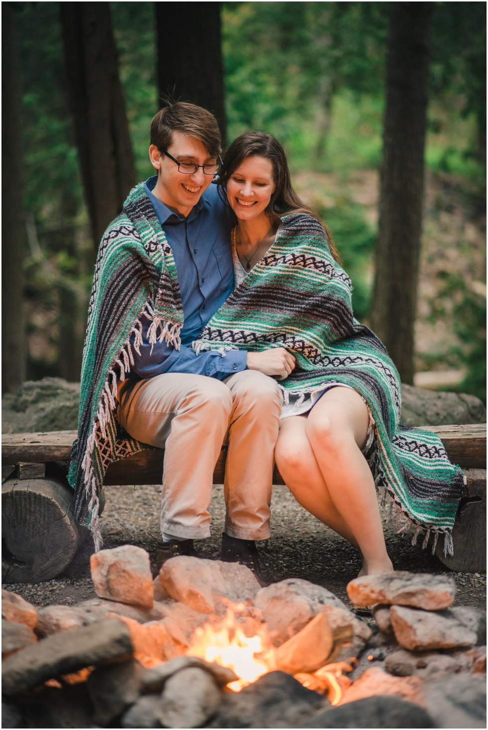 Couple enjoying the fire during their Hilton Falls engagement photos