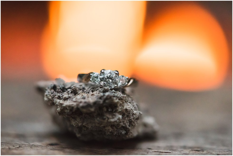 Engagement ring set on a rock by the fire