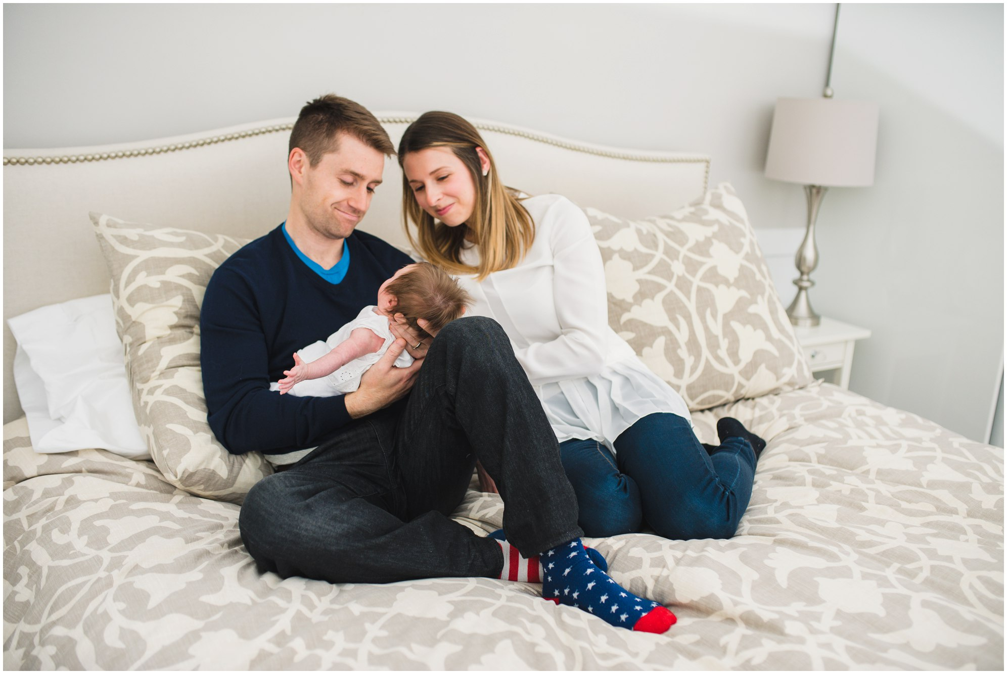 Parents holding their baby lovingly during their Toronto Newborn Lifestyle photos