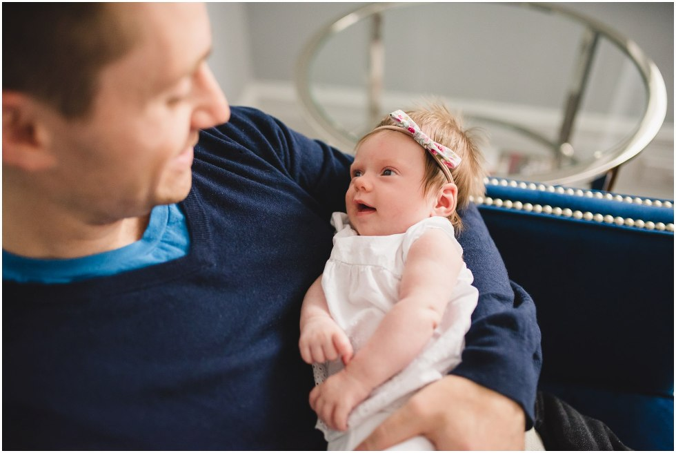Dad looking at his daughter during their Toronto Newborn LIfestyle photos