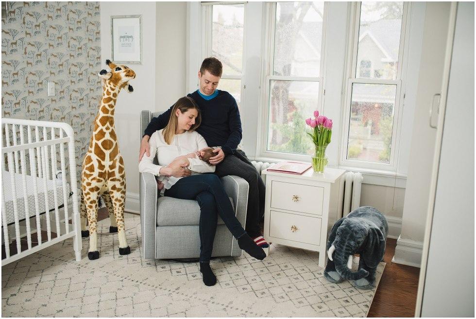 Parents holding their daughter during their Toronto Newborn Lifestyle photos