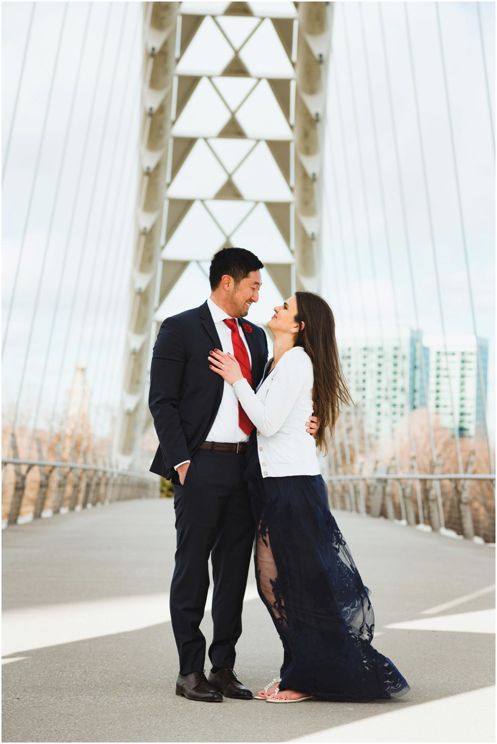 couple standing on white bridge with arms around each other Toronto Gillian Foster photography