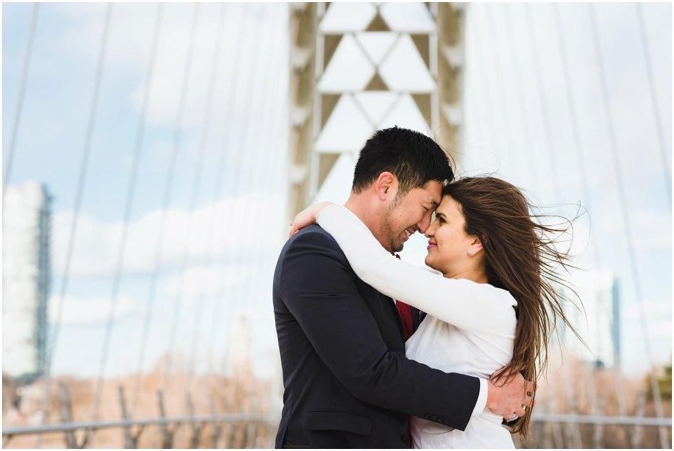 couple in loving embrace on white bridge Toronto proposal photography