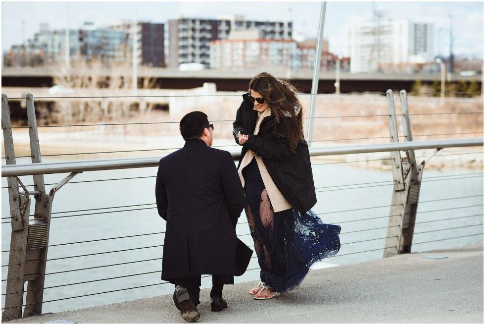 man proposing to woman on white bridge Toronto photographer Gillian Foster