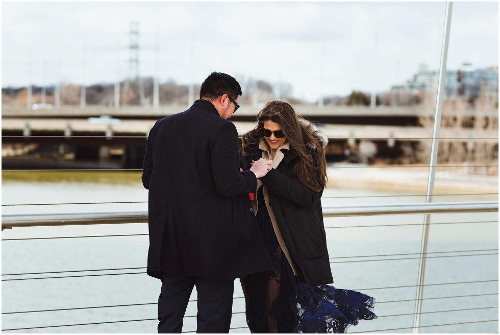 man proposing to woman on bridge Toronto