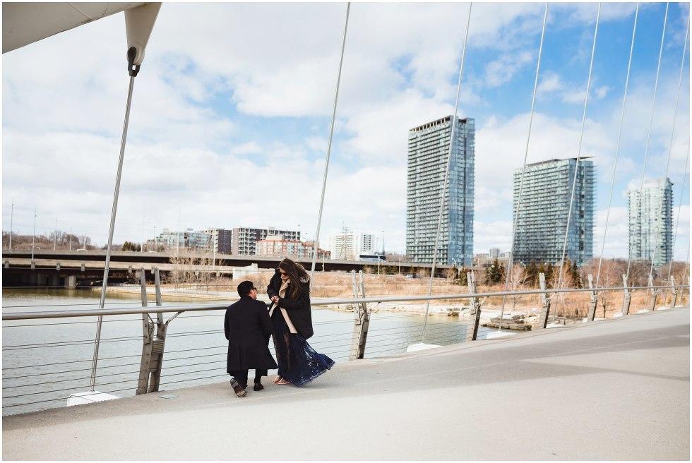 man proposing to woman on white bridge Toronto
