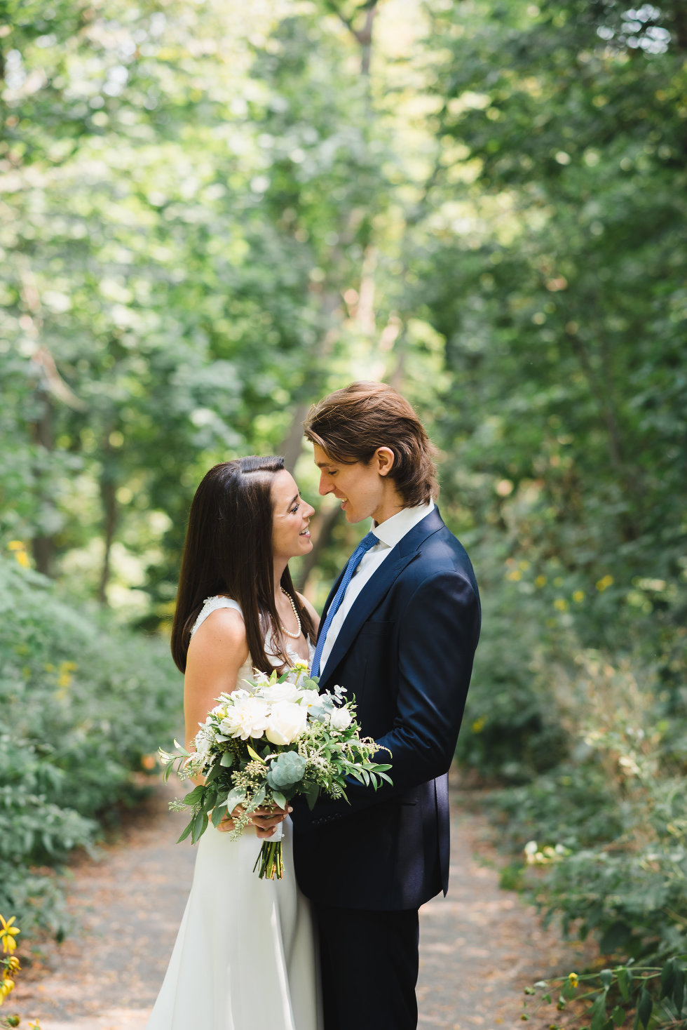 bride and groom in loving embrace surrounded by forest Toronto wedding photography