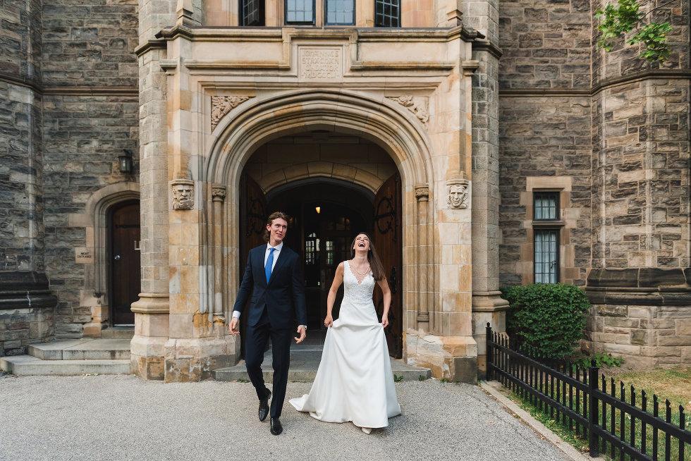 bride and groom exit church, bride laughs Toronto wedding photography