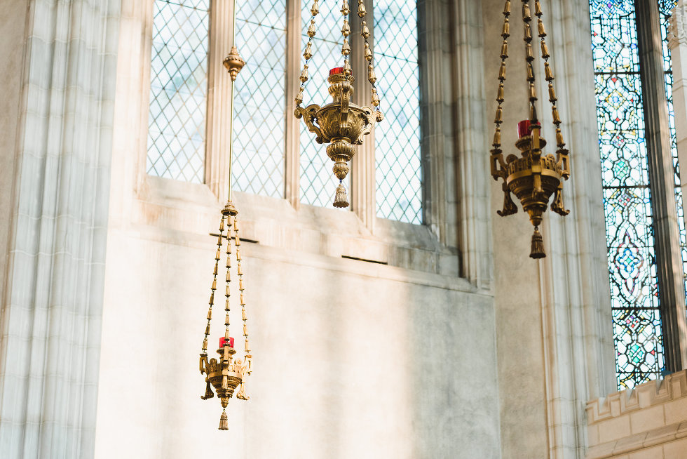 hanging brass candle holders in Trinity College at the University of Toronto wedding photography