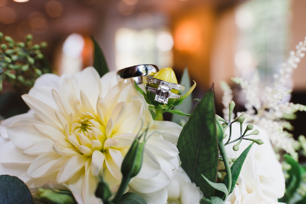 bride and grooms rings placed on flowers of the bouquet Toronto wedding photography