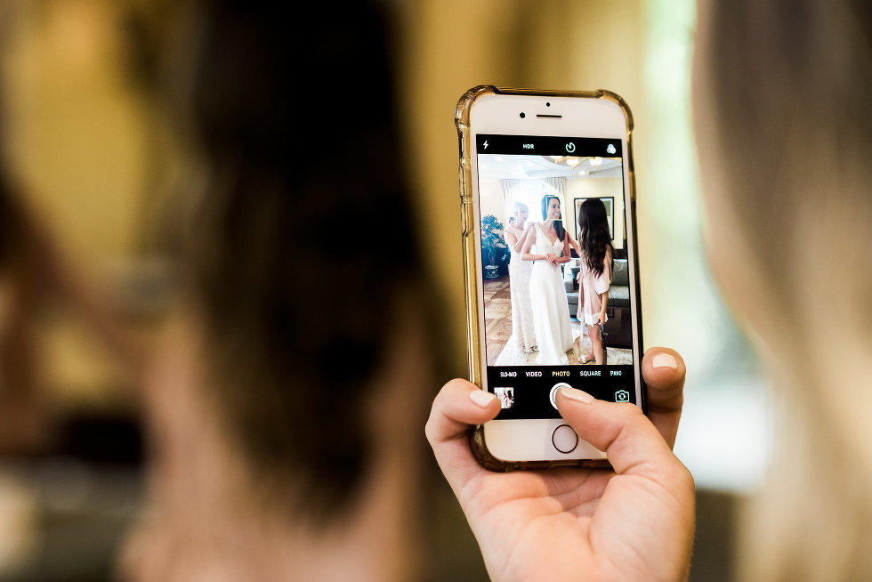 Iphone capturing a picture of bride getting ready Toronto wedding photographer