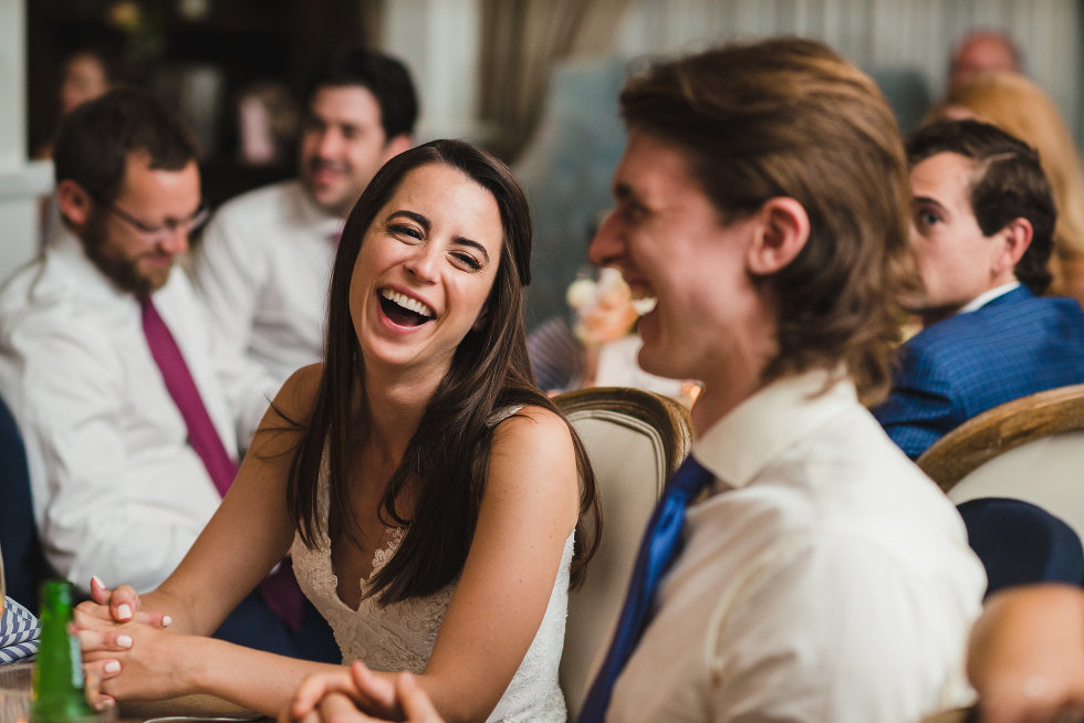 bride and groom laughing while surrounded by wedding guests Toronto wedding photography