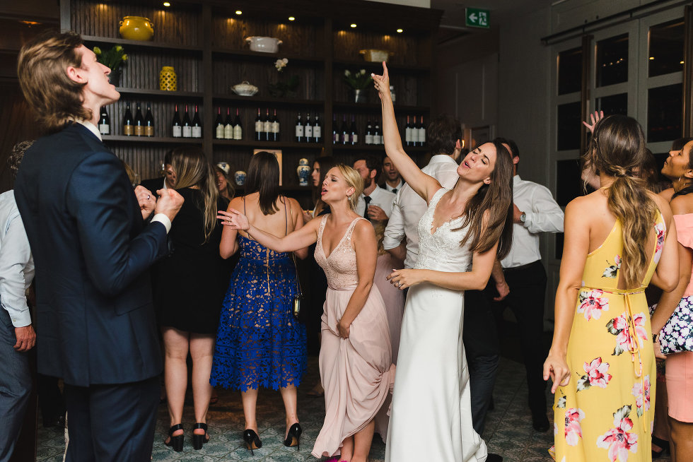 bride, groom, and wedding guests on the dance floor Toronto wedding photography Collette Grand Cafe