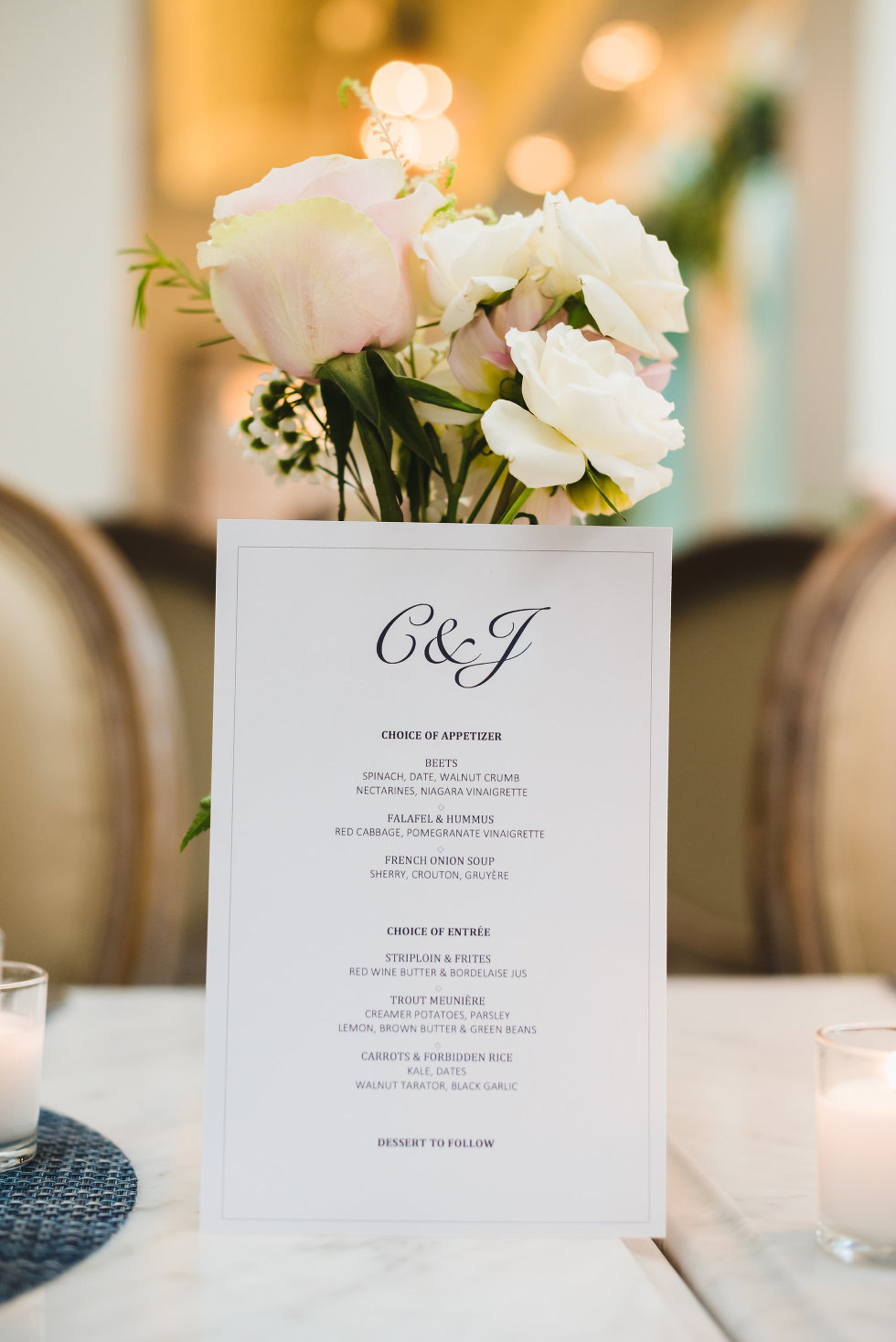 wedding menu propped up by floral centrepiece Toronto wedding photography