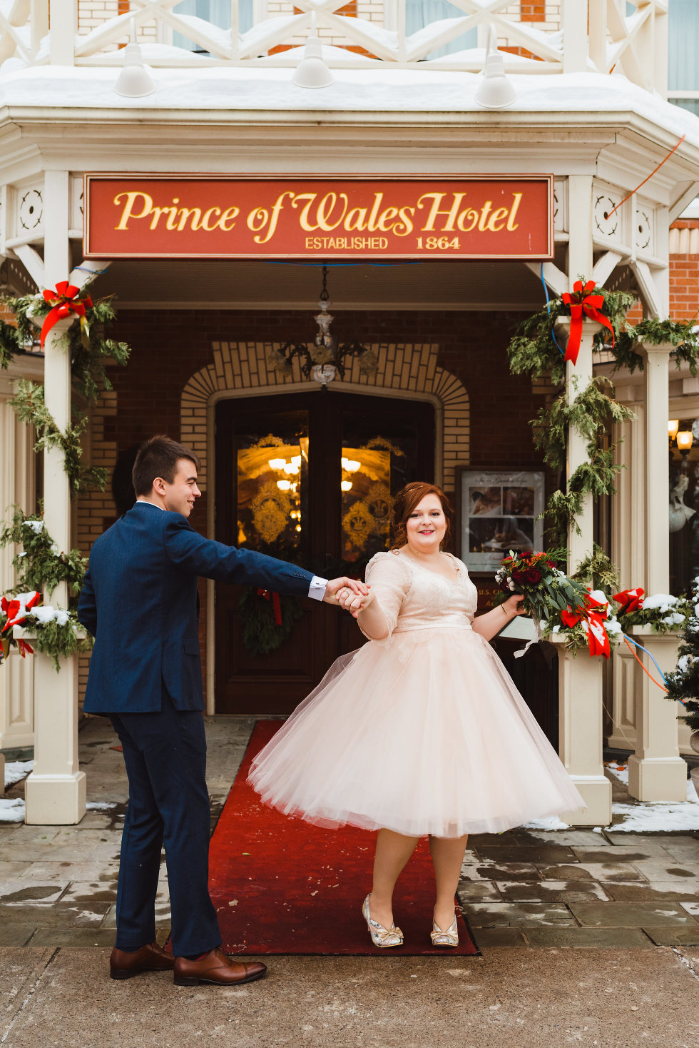 groom spins bride outside of Prince of Wales Hotel Niagara wedding