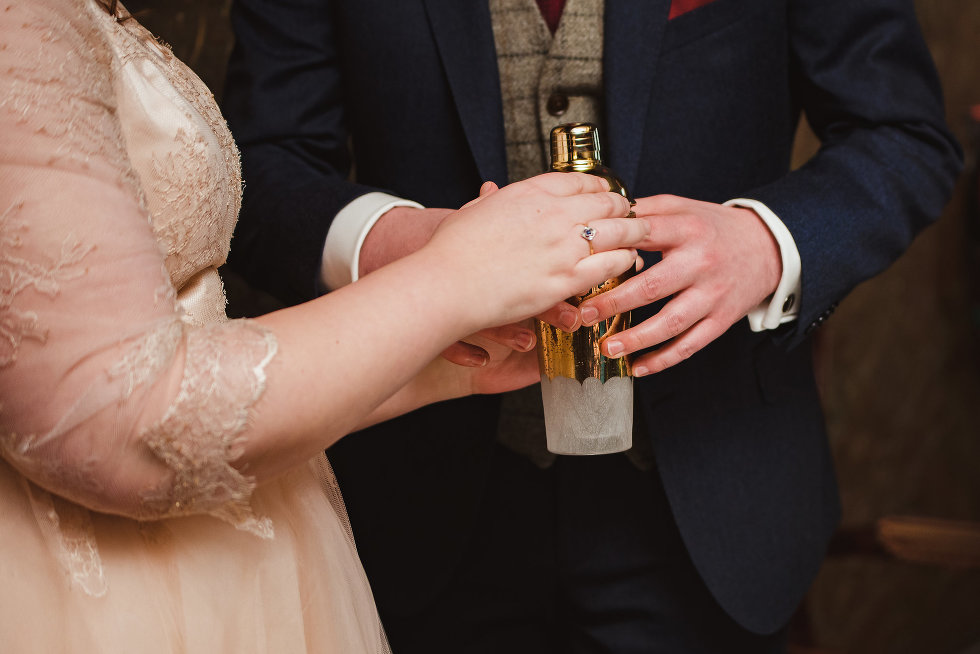 couple mixing cocktail in cocktail shaker, are you looking to add fun and unique ideas to your December wedding?