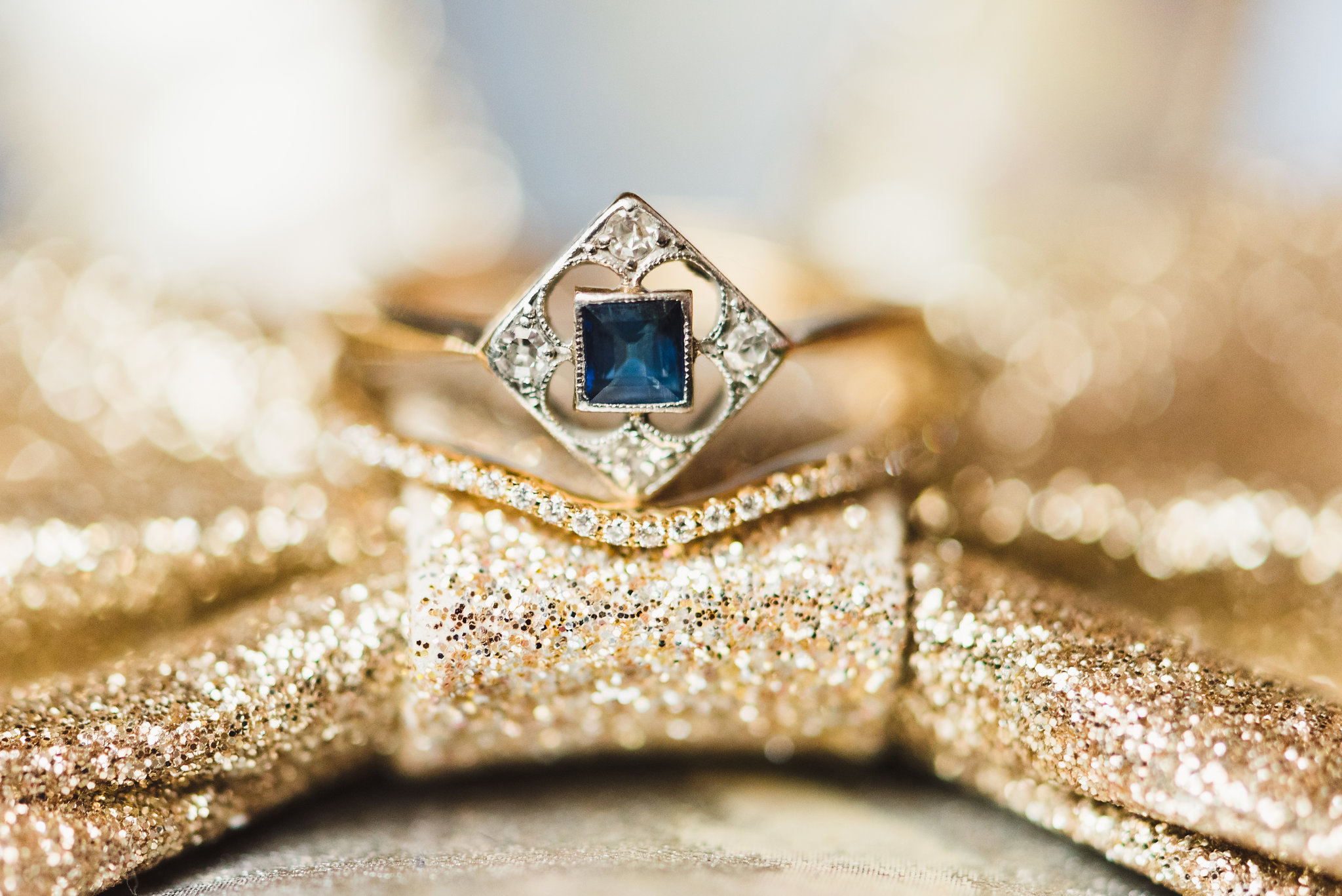 vintage silver and blue sapphire square ring on gold jewel bow Toronto wedding photographer Gillian Foster