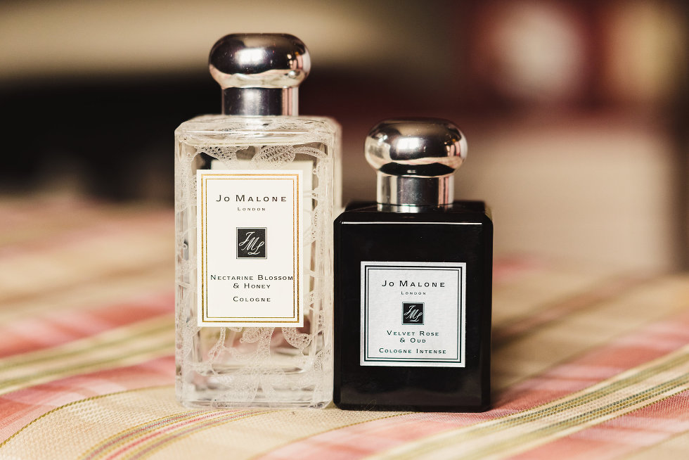 a white bottle and black bottle of Jo Malone colognes Niagara wedding