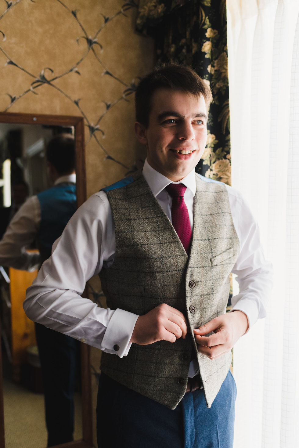 groom buttons up green tweed vest over white shirt and burgundy necktie Niagara wedding photography Gillian Foster