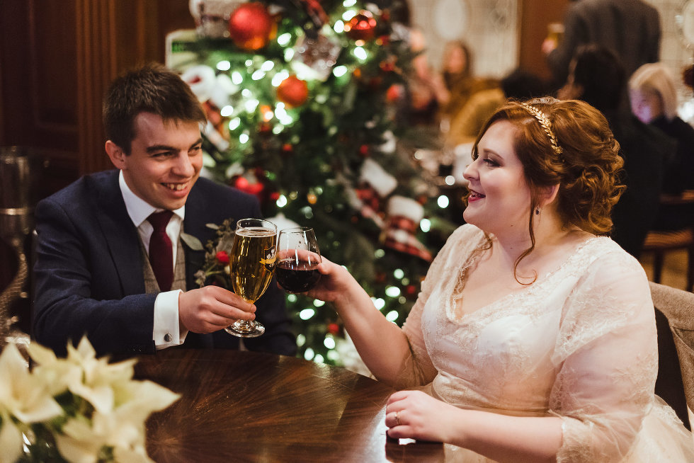bride and groom seated for reception white toasting with their drinks Prince of Wales Hotel Niagara wedding photography