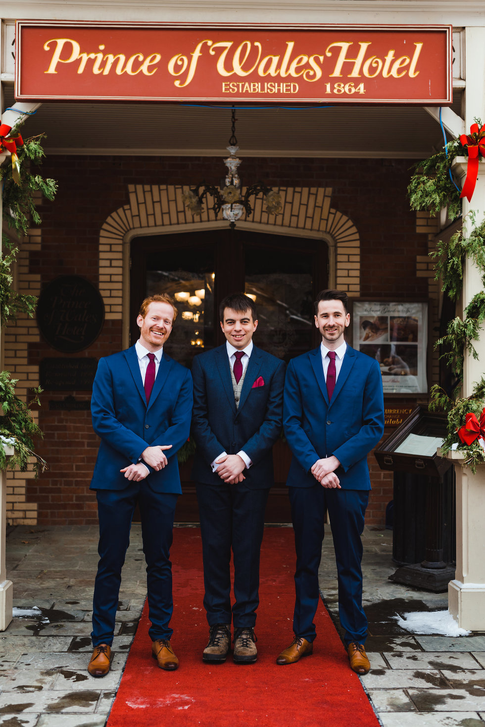 groom and groomsmen stand before the Prince of Wales Hotel Niagara wedding photography